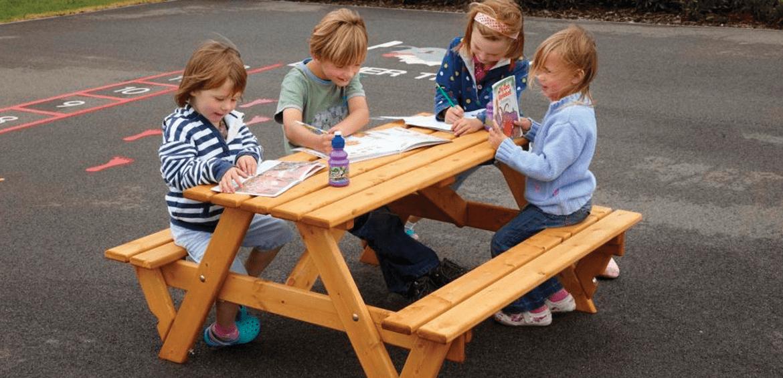 children sat a desk education product